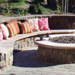 A fire pit with built-in seating.